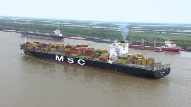 WS AERIAL POV View of Barataria Bay with MSC freighter / Louisiana, United States