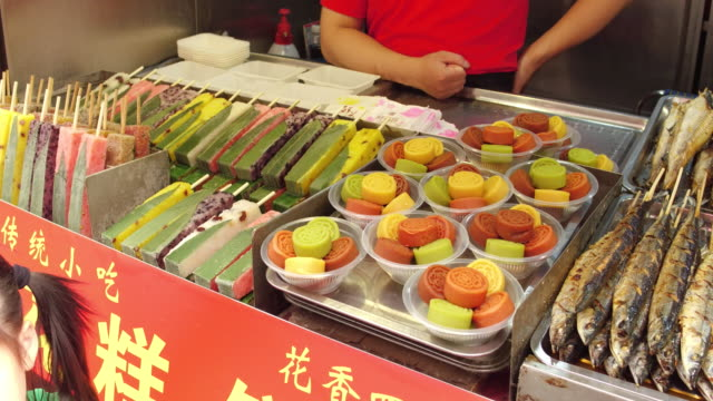 A view of barbecue in famous Wangfujing Snack Street on May 4 2017 in Beijing China Wangfujing is a main business street for tourism next to the...