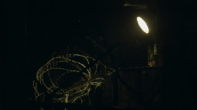 view of barbed-wire fence and lighting at night in dmz (demilitarized zone, a strip of land running across the korean peninsula), south korea - chainlink fence stock videos and b-roll footage