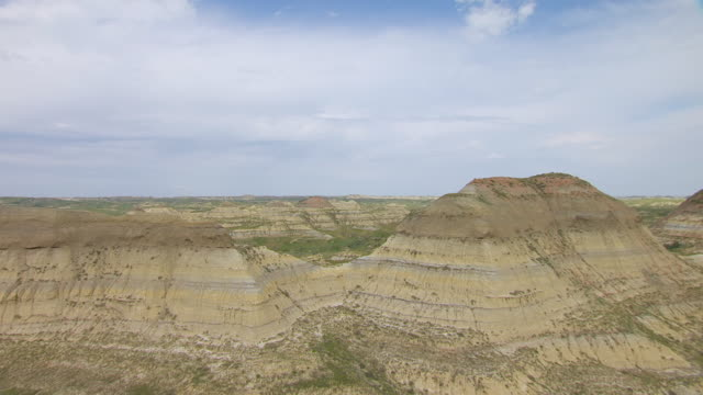 WS AERIAL View of Bare hills in Badlands in Theodore Roosevelt National Park / North Dakota, United States