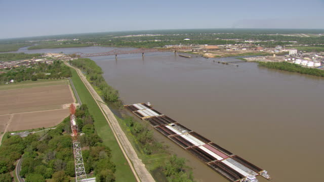 ws aerial view of barges in mississippi river with trucks and cars driving over / louisiana, united states - barge stock videos & royalty-free footage