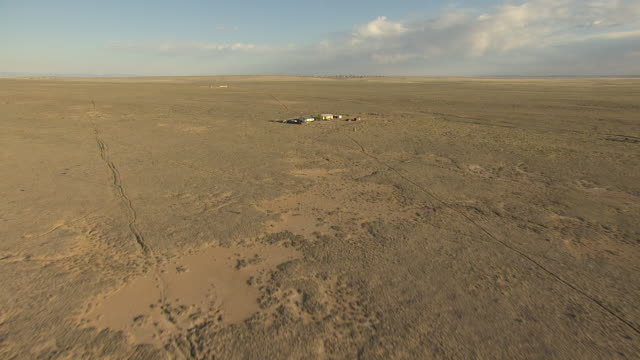 WS AERIAL View of barren desert and house in San Juan County / New Mexico, United States