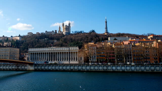 view of basilica of notre dame de fourvière and rhone river in lyon - rhone river stock videos & royalty-free footage