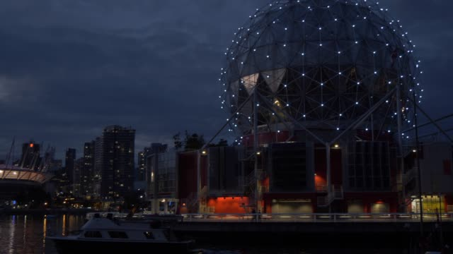 View of BC Place Stadium and Science World at TELUS World of Science at dusk Vancouver British Columbia Canada North America