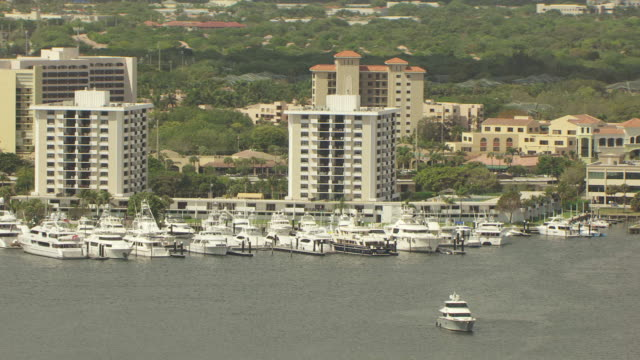 WS AERIAL View of beach and boats docked at Old Port Cove Marina / Palm Beach, Florida, United States
