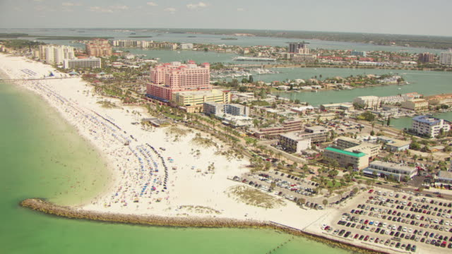 WS AERIAL View of beach and condos and houses on land / Clearwater Beaches, Florida, United States