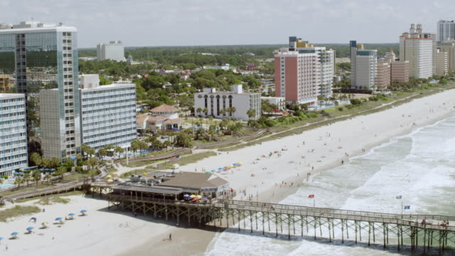 ws aerial pov view of beach and hotels / myrtle beach, south carolina, united states - myrtle beach stock videos & royalty-free footage