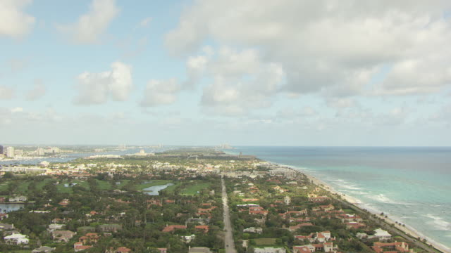 WS AERIAL View of beach and housing developments on land / Palm Beach, Florida, United States