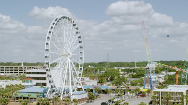 WS AERIAL POV View of beach and Myrtle Beach SkyWheel with hotels / Myrtle Beach, South Carolina, United States