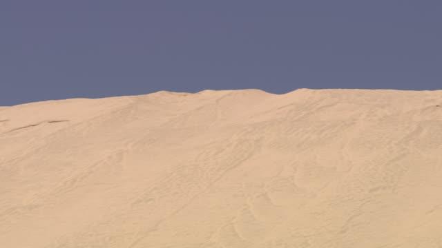 ws pan view of beach and sand / doha, qatar  - doha stock videos & royalty-free footage