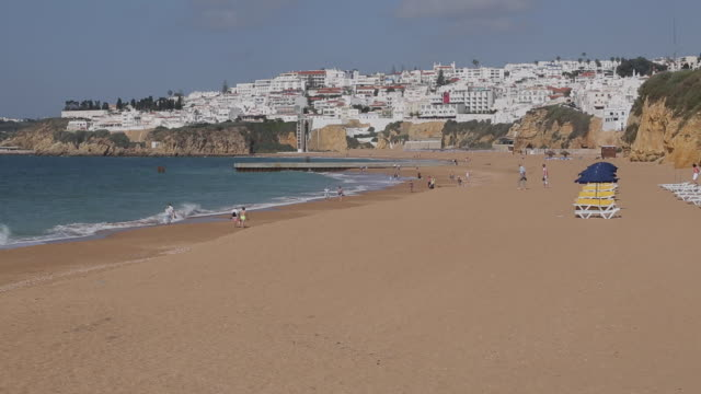 view of beach and town, albufeira, algarve, portugal, europe - algarve stock videos & royalty-free footage