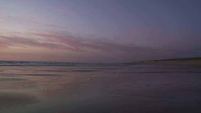 ws view of beach on atlantic coastline after sunset / cap de l'homy, aquitaine, france - aquitaine stock videos and b-roll footage