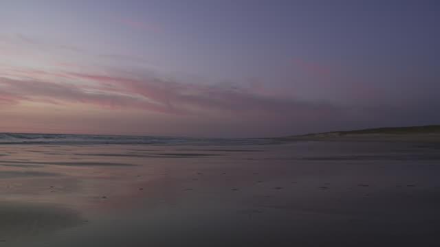 WS View of beach on Atlantic coastline after sunset / Cap de l'Homy, Aquitaine, France