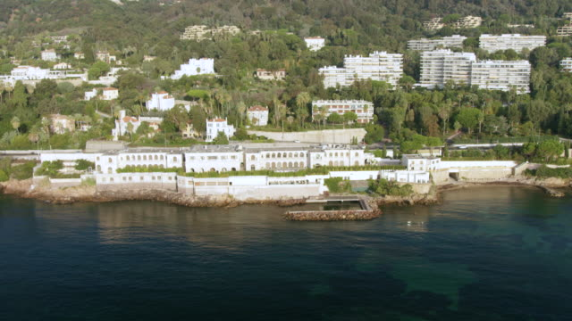 WS AERIAL POV View of beach resort and surrounding area / Antibes, Cannes, France