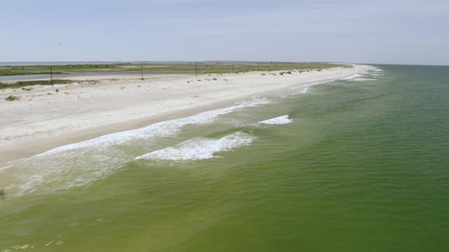 ws aerial pov view of beach / rodanthe, north carolina, united states - north carolina beach stock videos & royalty-free footage