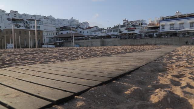 view of beach scene, albufeira, algarve, portugal, europe - algarve stock videos & royalty-free footage