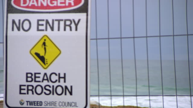 WS PAN R/F View of Beach to No entry beach sign / Kingscliff, New South Wales, Australia