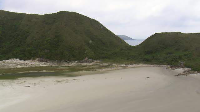 ws aerial view of beach with hill area / sao paulo, brazil - hill点の映像素材/bロール