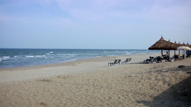 ws view of beach with sun loungers and sunshades / danang, thailand - danang stock videos & royalty-free footage