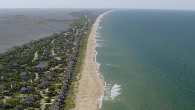 ws aerial pov view of beach with townscape / kitty hawk, north carolina, united states - carolina beach stock videos & royalty-free footage