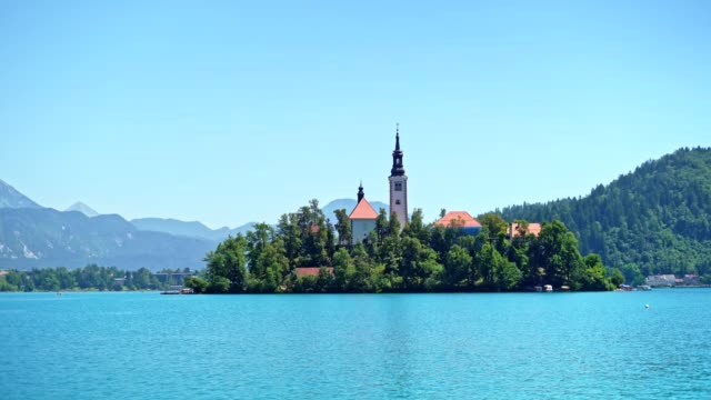 view of beautiful lake bled with small island and church - lake bled stock videos & royalty-free footage