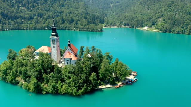view of beautiful lake bled with small island and church - lago di bled video stock e b–roll