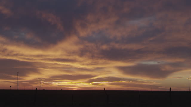 ws view of beautiful orange and blue sunset over rural landscape / sanford, texas, united states - southwest florida stock videos & royalty-free footage