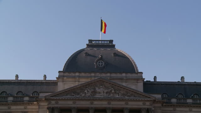 MS View of Belgium flag swaying on breeze on royal Palace / Brussels, Belgium