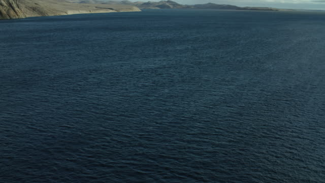 view of bellot strait with somerset island - tilt up stock videos & royalty-free footage
