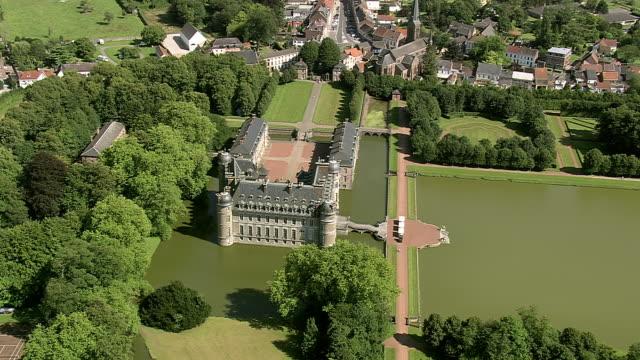 ms aerial zo zi pan view of beloeil castle with garden / walloon region, belgium - castle stock videos & royalty-free footage