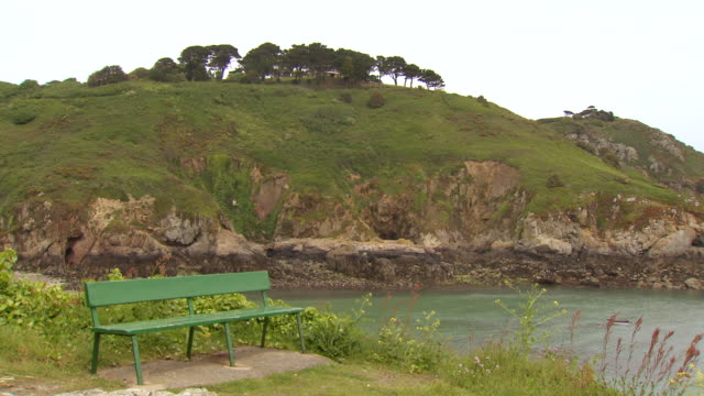 ws view of bench positioned on edge of the cliff / st. peter port, guernsey, united kingdom - guernsey stock videos and b-roll footage