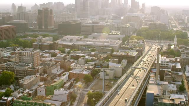 MS TU AERIAL View of benjamin franklin bridge and city with skyscrapers / Philadelphia