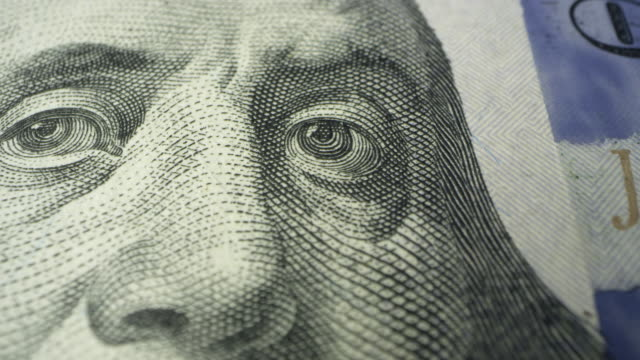 view of benjamin franklin's eyes on 100 dollar bill - benjamin franklin video stock e b–roll