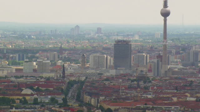 WS AERIAL View of Berlin TV tower and city with cloudy sky / Germany