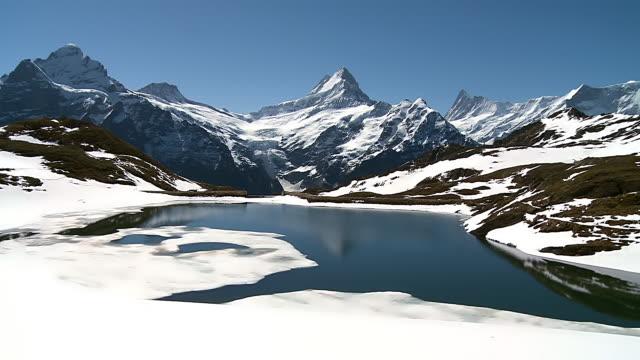 ws pan view of bernese alps mountain range / grindelwald, bernese oberland, switzerland - bernese alps stock videos & royalty-free footage