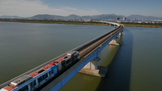 view of bgl (busan-gimhae light rail transit) on the railway in busan, south korea - busan stock videos & royalty-free footage