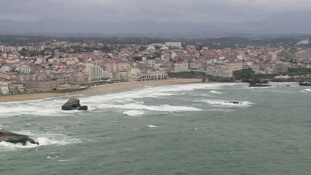 ws aerial view of biarritz city on bay of atlantic coast / aquitaine, france - aquitaine stock-videos und b-roll-filmmaterial
