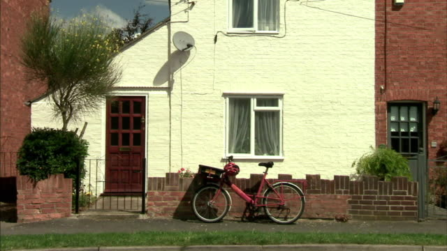 ws view of bicycle in front of house / milton keynes, uk - house stock videos & royalty-free footage