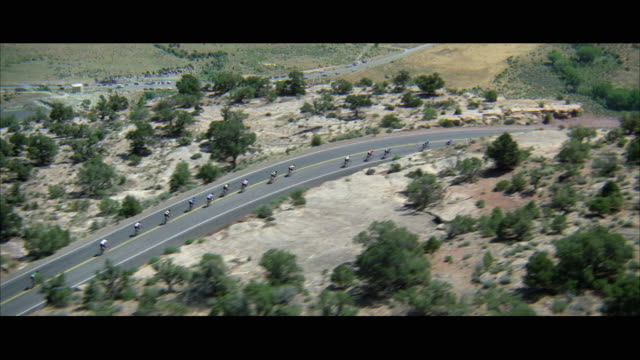 WS TS POV AERIAL View of bicycle racers on mountain road