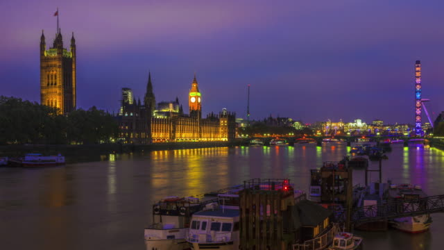 View of Big Ben, and the London Eye at night.