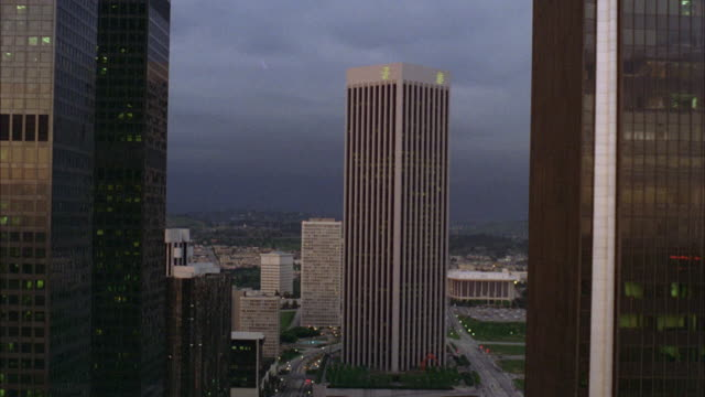 ws view of big building and six lane street in downtown los angeles at dusk - anno 1978 video stock e b–roll
