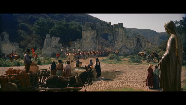 stockvideo's en b-roll-footage met ms view of big courtyard people standing near well and british troops  horse cavalry moving  - letterbox format