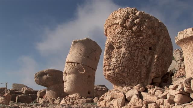 ms view of big heads of statues among ruins / mount nemrut, adiyaman, southeast turkey,turkey - ruined stock videos & royalty-free footage