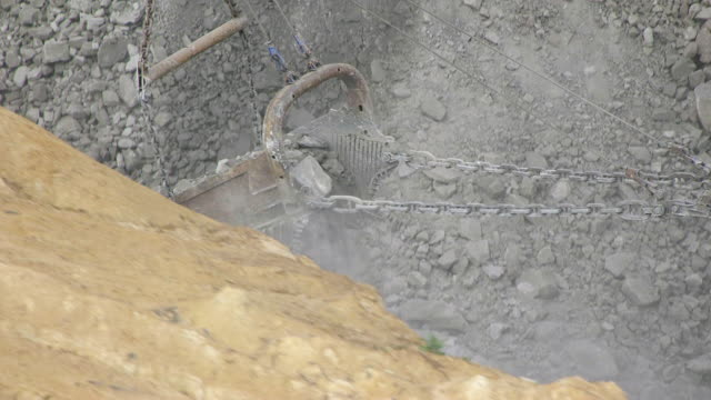 cu ts aerial view of big john excavator digging land at hobet 21 mine / west virginia, united states - land mine stock videos and b-roll footage