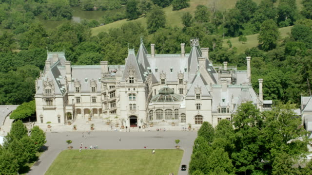 WS AERIAL POV View of Biltmore Estate with forest area / Asheville, North Carolina, United States