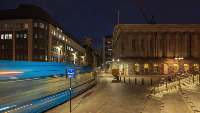 view of birmingham city centre with metro tram at night- 4k time-lapse - west midlands stock videos & royalty-free footage