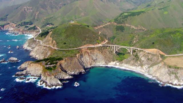 ws ds aerial view of bixby creek bridge at coast of pacific ocean / california, united states - bixby creek bridge stock videos & royalty-free footage
