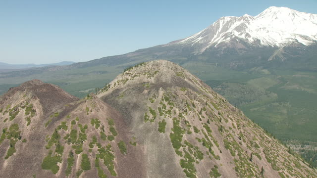 WS AERIAL POV View of black butte with Mount Shasta in background / California, United States