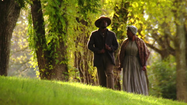ws tu view of black man wearing union uniform walking with black woman and puts his arm around her shoulders / culpeper, virginia, united states - slavery stock videos & royalty-free footage