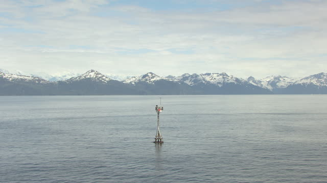 ms aerial zo view of bligh reef navigation marker at prince william sound / alaska, united states - prince william stock videos & royalty-free footage